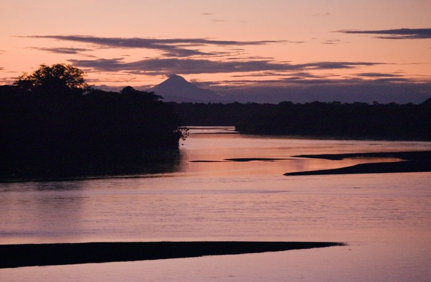 A view of the Pastaza River from Sharamentza with the Sangay volcano in the background. The eastern slope of the volcano is the beginning of the Amazon basin.