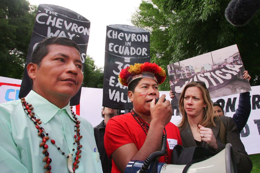 Secoya indigenous leader Humberto Piaguaje (C) is joined by Kichwa leader Guillermo Grefa (L) as he speaks to the press and supporters after emerging from Chevron's (formerly Texaco) annual shareholders meeting in San Ramon, California in 2007.