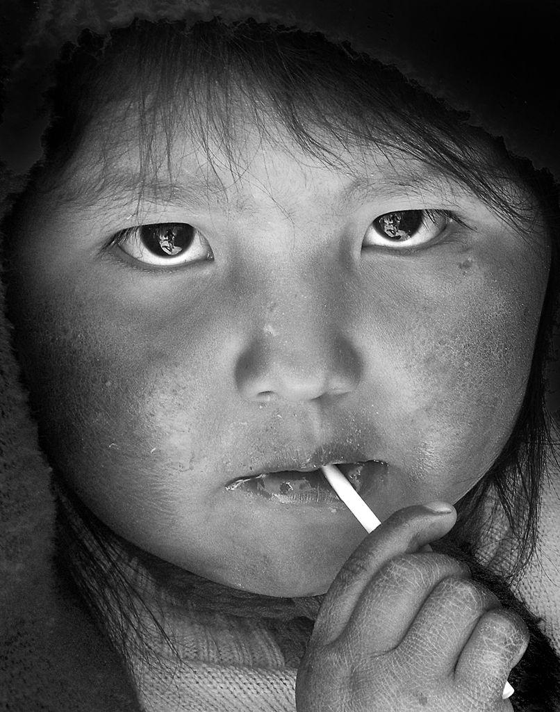 Girl with Lollipop, Taquile Island ©2009 L. Aviva Diamond