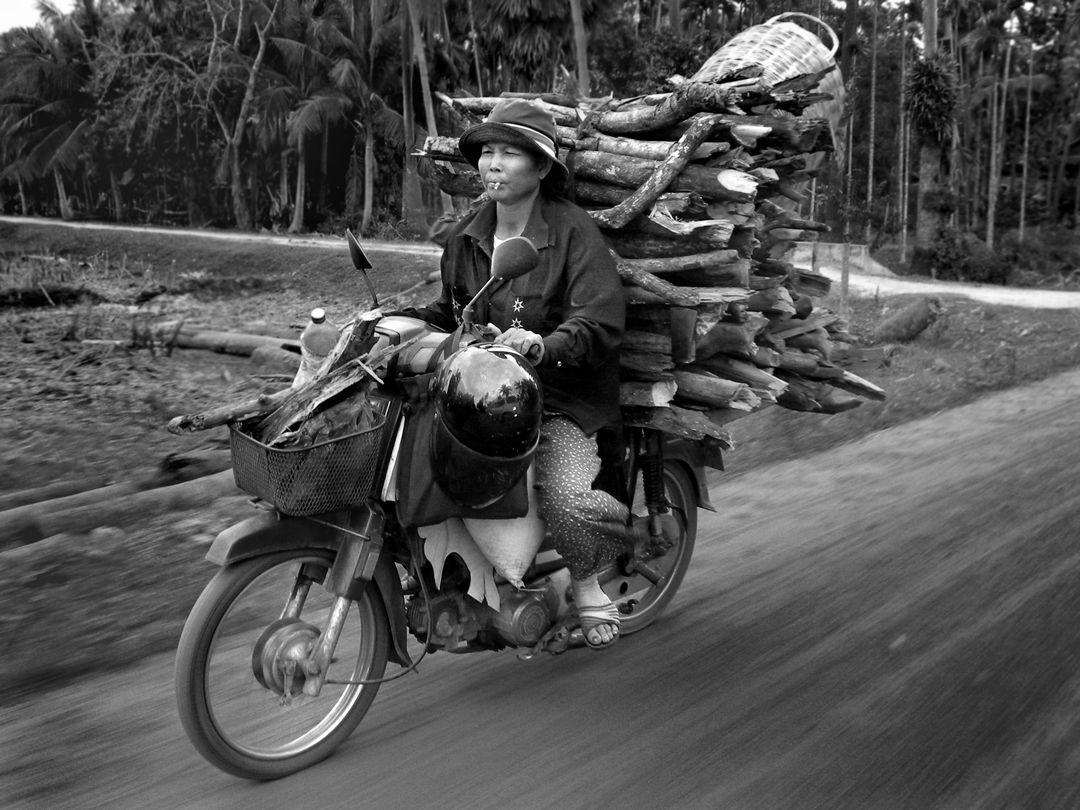 Motorcycle Woman, Cambodia 2013 ©2013 L. Aviva Diamond