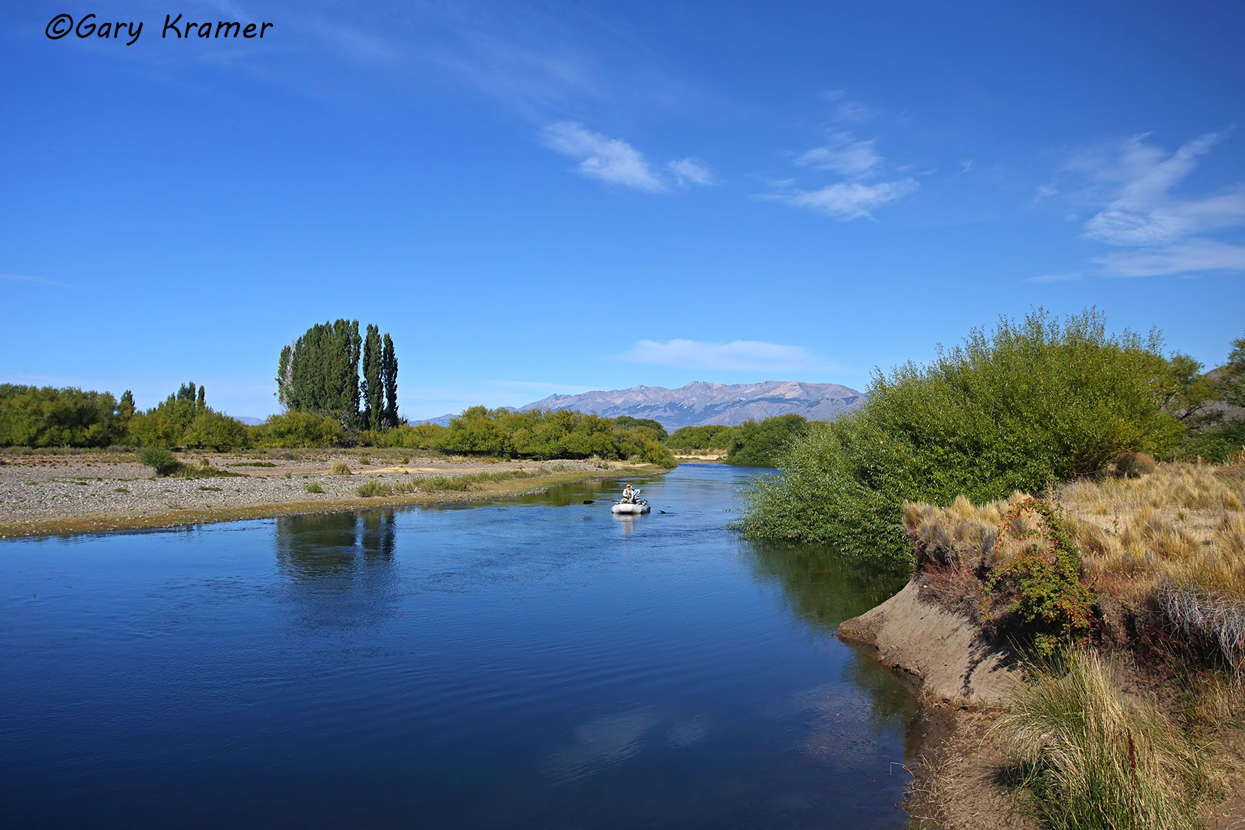 Flyfisherman/guide floating the Chubut River, Argentina - SFAcr#020d