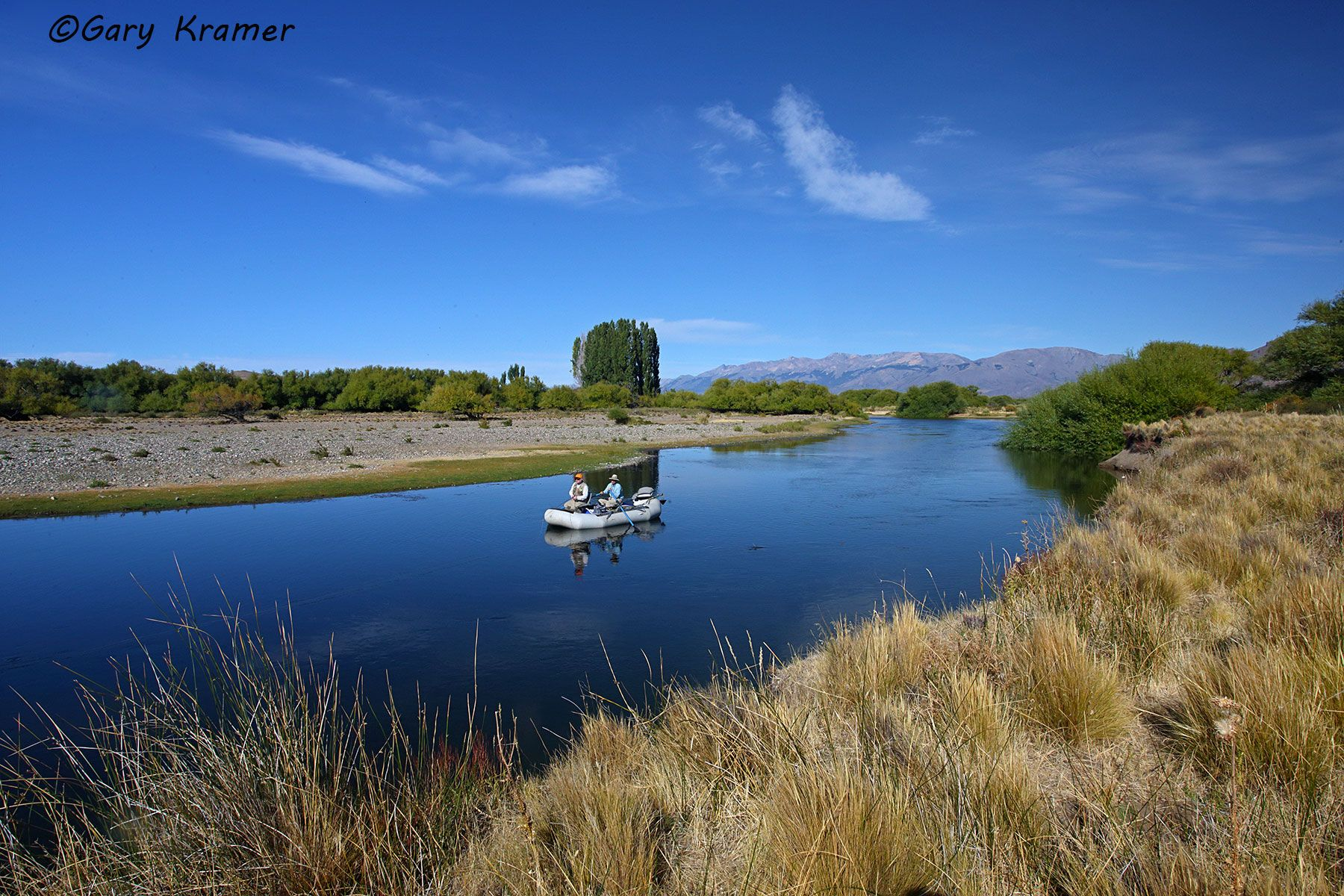 Flyfisherman/guide floating the Chubut River, Argentina - SFAcr#059d