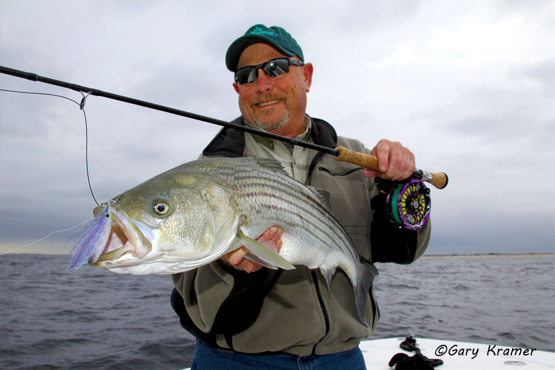 Flyfisherman (Carl Rey) w/Striped Bass - NFSsb#026d