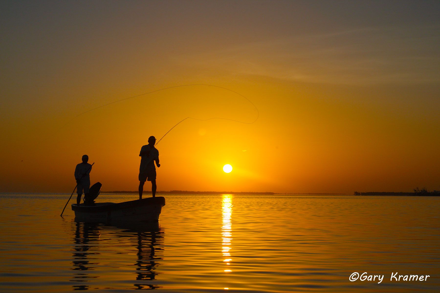 Flyfisherman/guide fishing from boat at sunrise/sunset, Mexico - NFFsg#185d