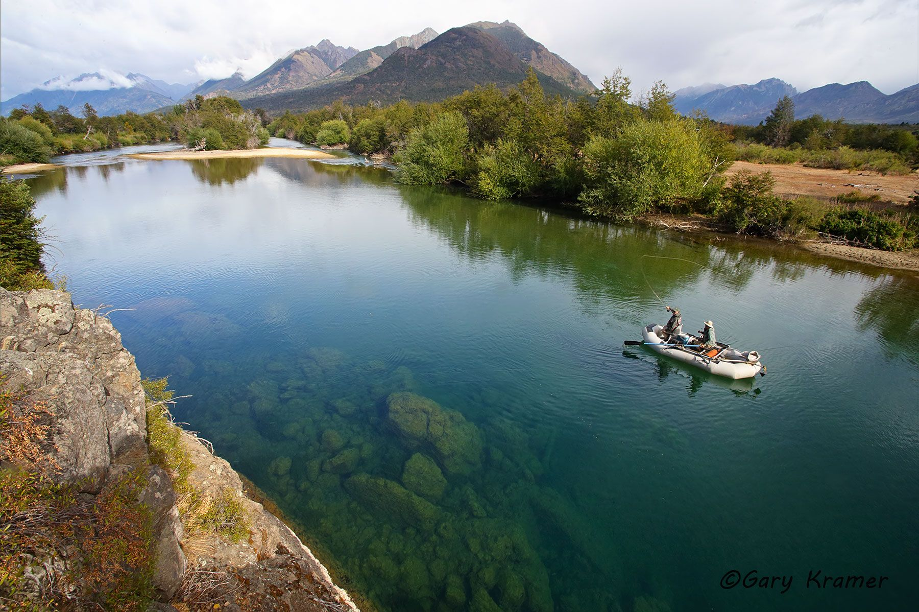 Flyfisherman/guide floating the Carrileufu River, Argentina - SFArc#013d