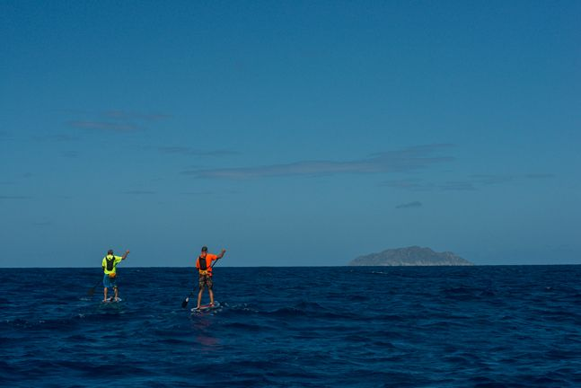 Greg Jaudon and Erick Bedborz half way on their 28 mile trip from Isabela to Desecheo Island. Crossing part of the Mona Canal om MHL Custom paddle boards. July 13 2016.