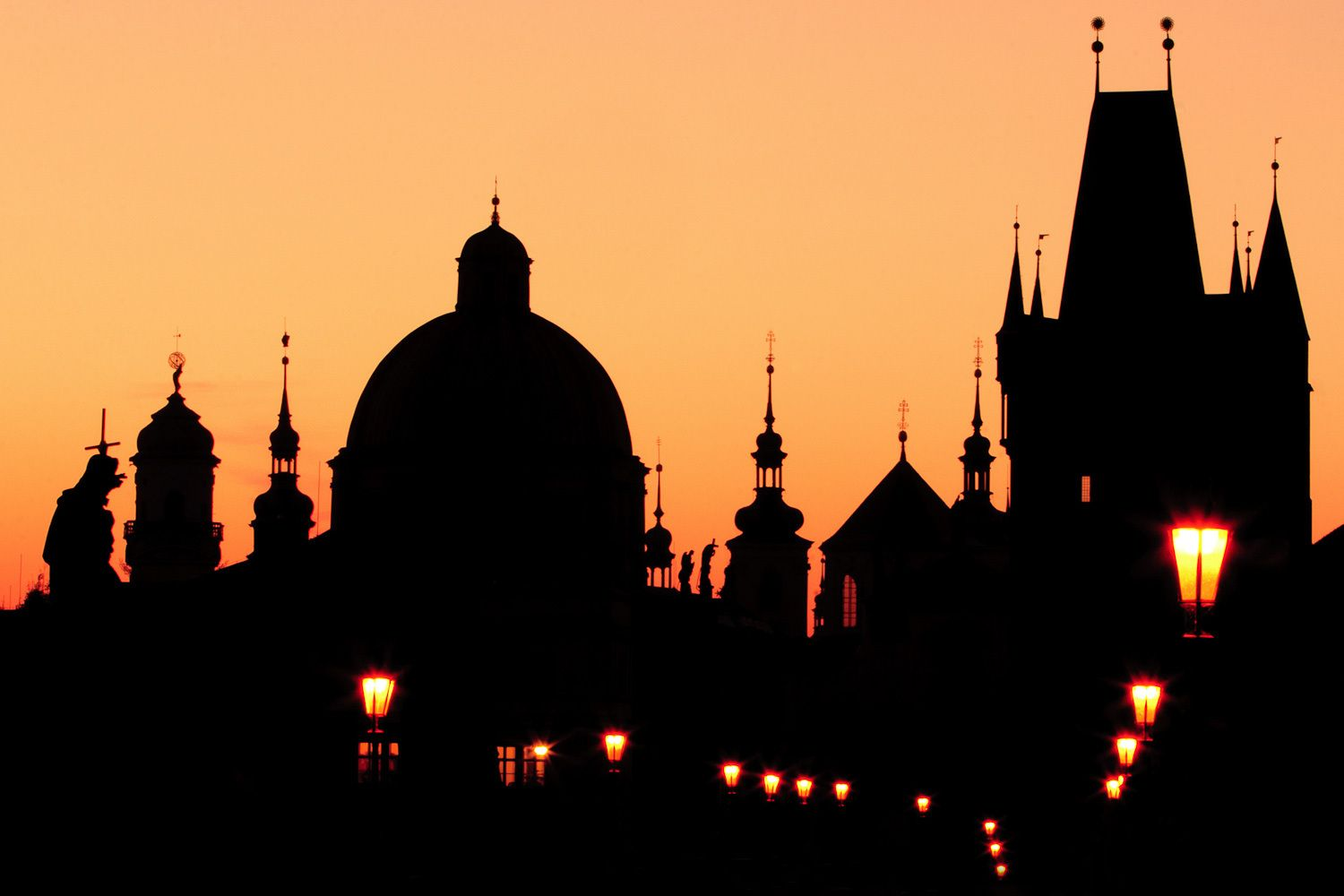 Silhouette of buildings from Charles Bridge at dawn, Prague, Czech Republic.