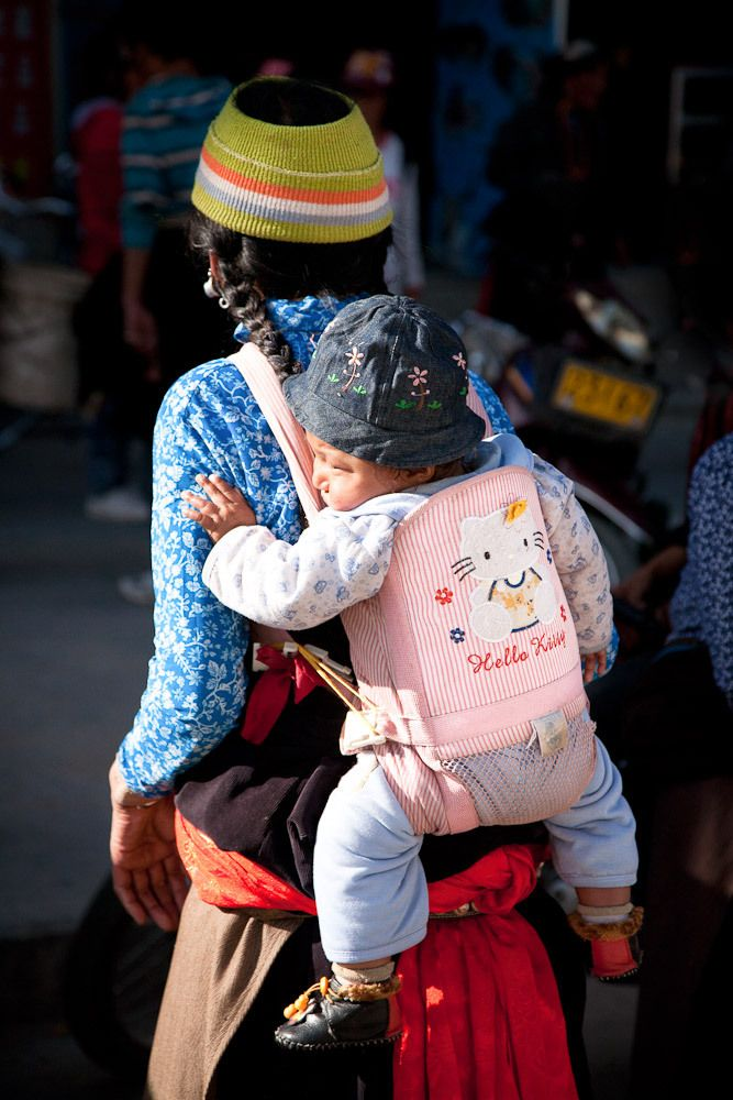 Tibetan lady with her child, Xiahe, Gansu, China.