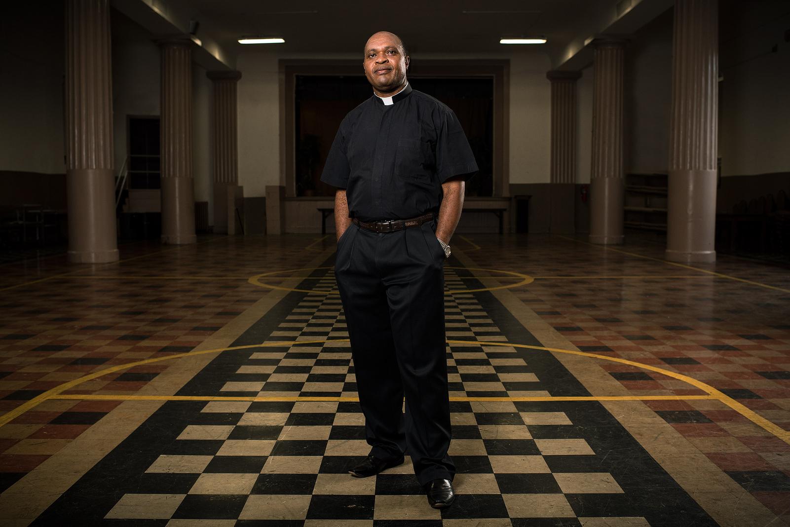 catholic_charities_AA_priest copy.jpg