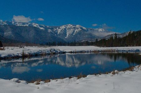 Grizzly Ridge From The Heart K Ranch Pond, Genesee Valley, Northern Sierra Nevada, California, 2011 by David Leland Hyde.