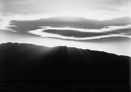 Sun Illuminated Clouds Over Death Valley National Park, California