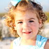 Image of child's face at beach