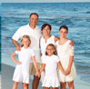 Family of five posing for a family beach picture