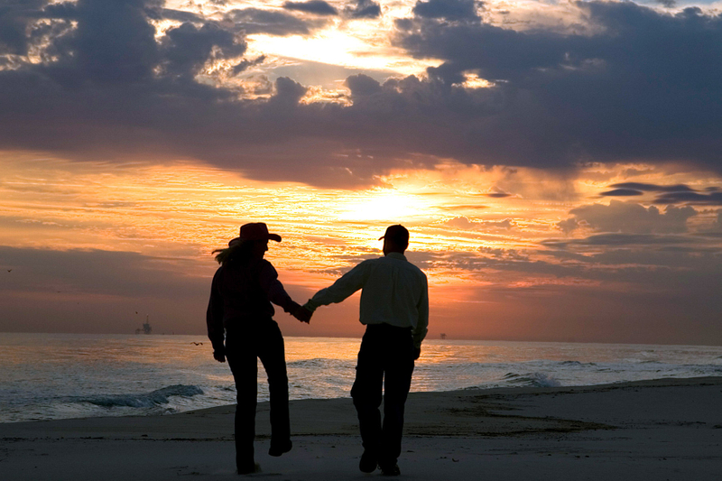 Couple walking in to the sunset