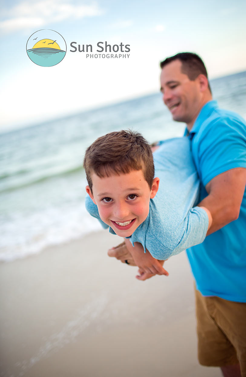 Dad and son goofing off at the beach