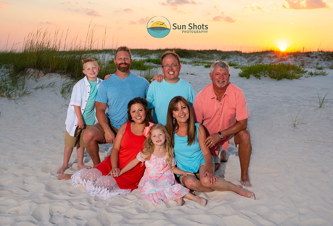 Photo of Family on Beach with sunset in background