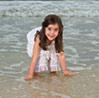 Image of girl playing along seashore