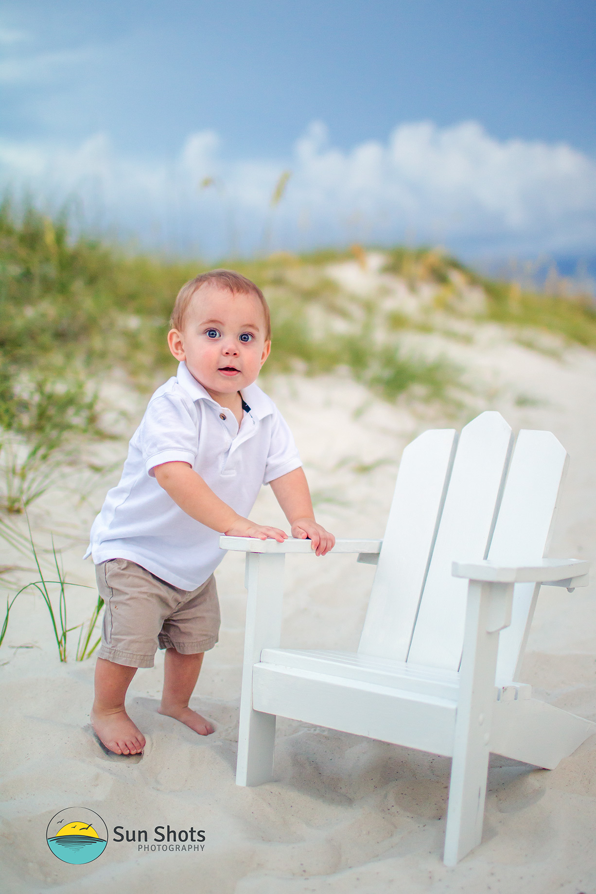 Boy posing for picture on beach