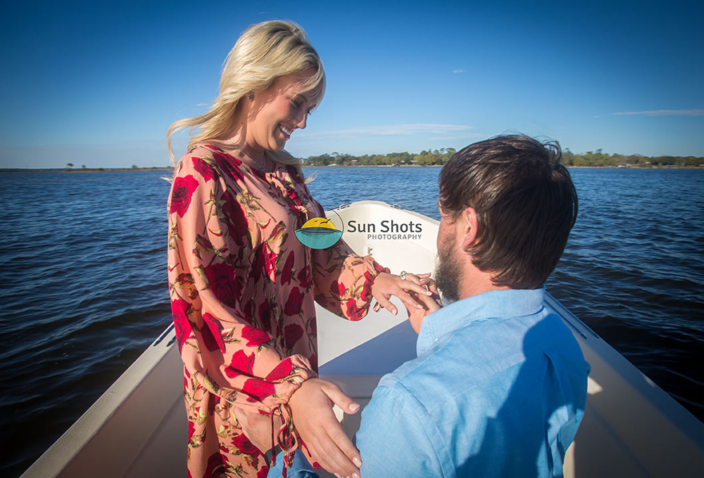 A surprise proposal on the bow of the boat