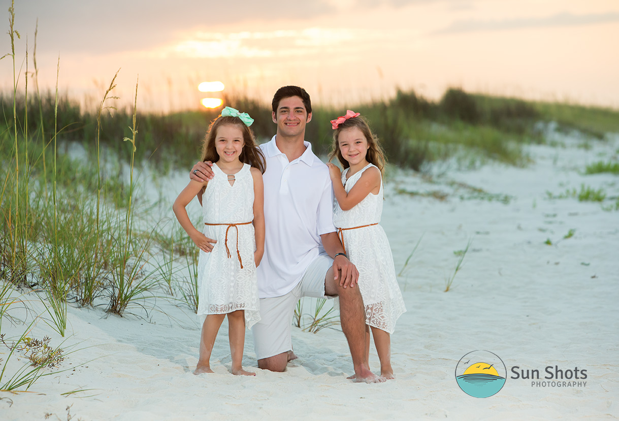 Siblings posing for sunset photograph