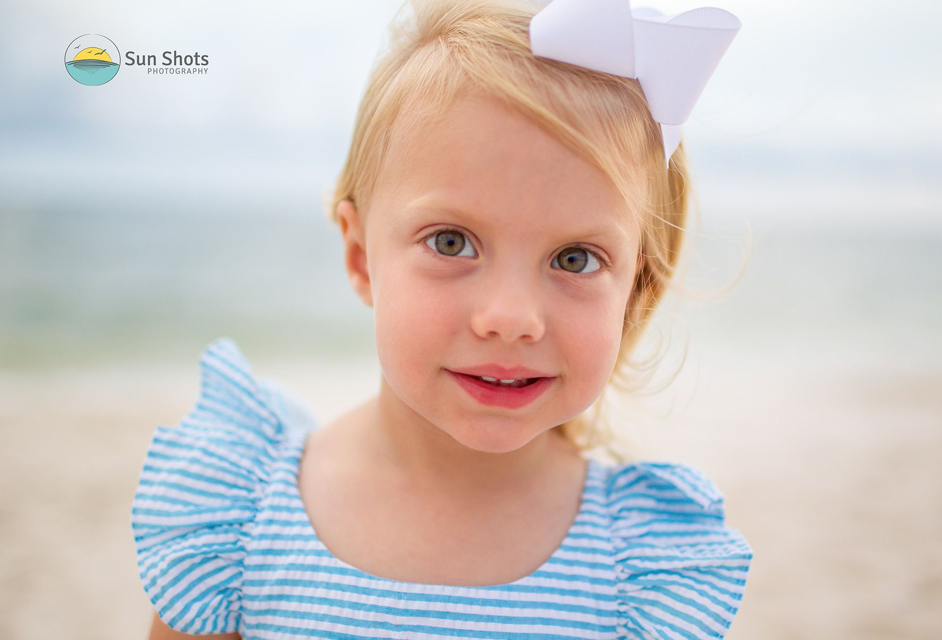 Image of young girl looking into camera
