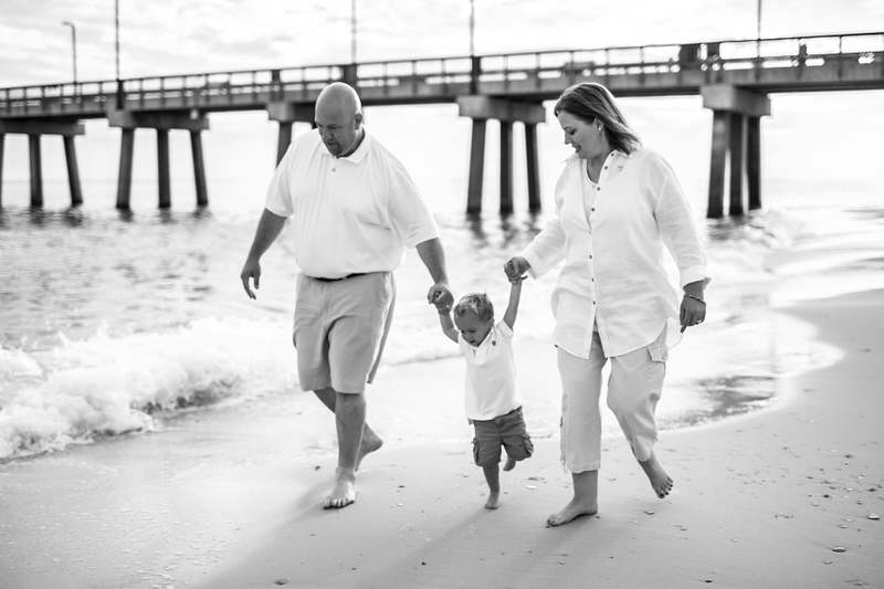 Candid picture of family walking on beach