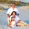 Family of three on beach