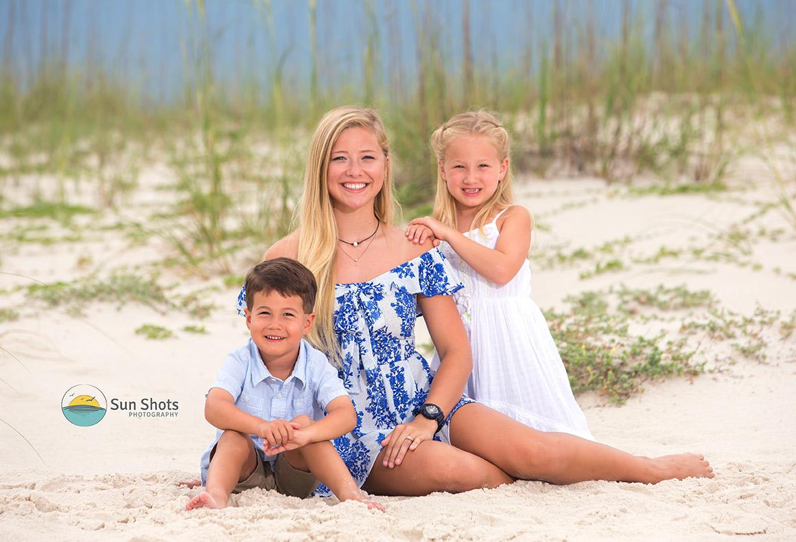 Siblings posing for photo on beach
