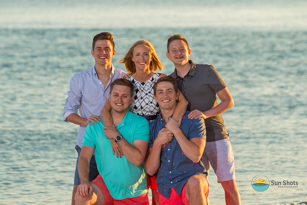 Photography with mom and four sons with ocean in background