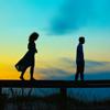 Image of two teenager siblings walking on boardwalk rail at sunrise