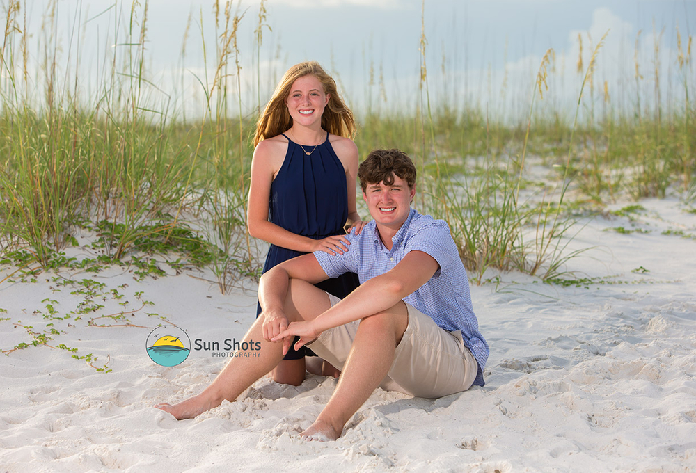 Brother and Sister posing for photograph on beach