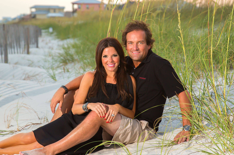 Couples nestled into the dunes for a portrait