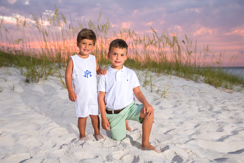 Brothers at beach with sunrise in background
