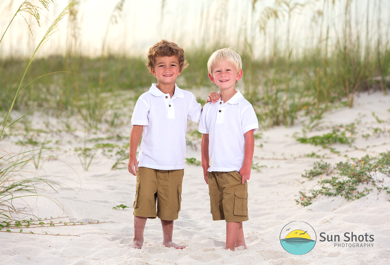 Two brothers taking beach picture