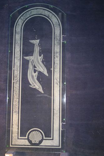 Made by Classical Glass and used as an example in Custom Glass Industries as a sample of what can be done on these heavy plate doors.Shower Door Dolphin