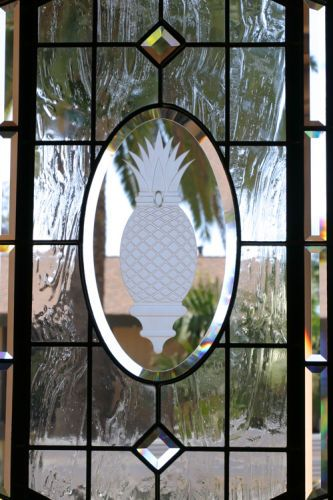 Carved glass of a Pineapple to look like jewelery in a door.Private residence - Corona Del Mar, CA