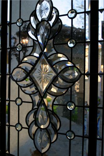 Custom art window for the Trout Residence, by Classical Glass Studios.Close up of center section
