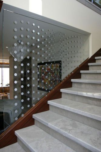 Stairway with etched art glass. Artist De Carter, Architect Chris Light, and Carol McMahon Interior Designs..
