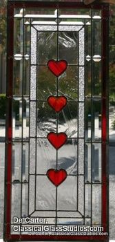 Custom leaded glass window with art glass hearts.