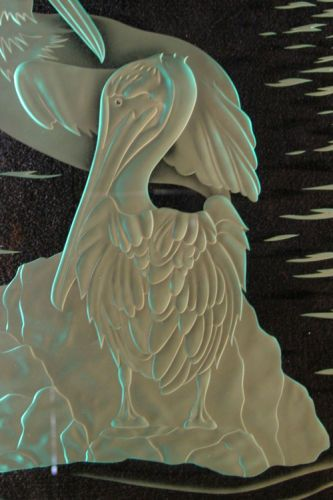 Pelican deeply carved in glass