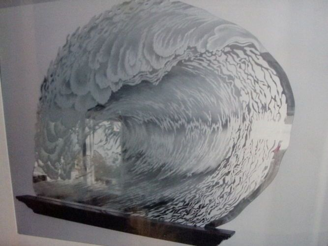 """Surfer dreams "" carved, etched wave mirror.  Stunning, original art glass. A perfect barreling left. The top edge of the wave feathering into the wind in flames."