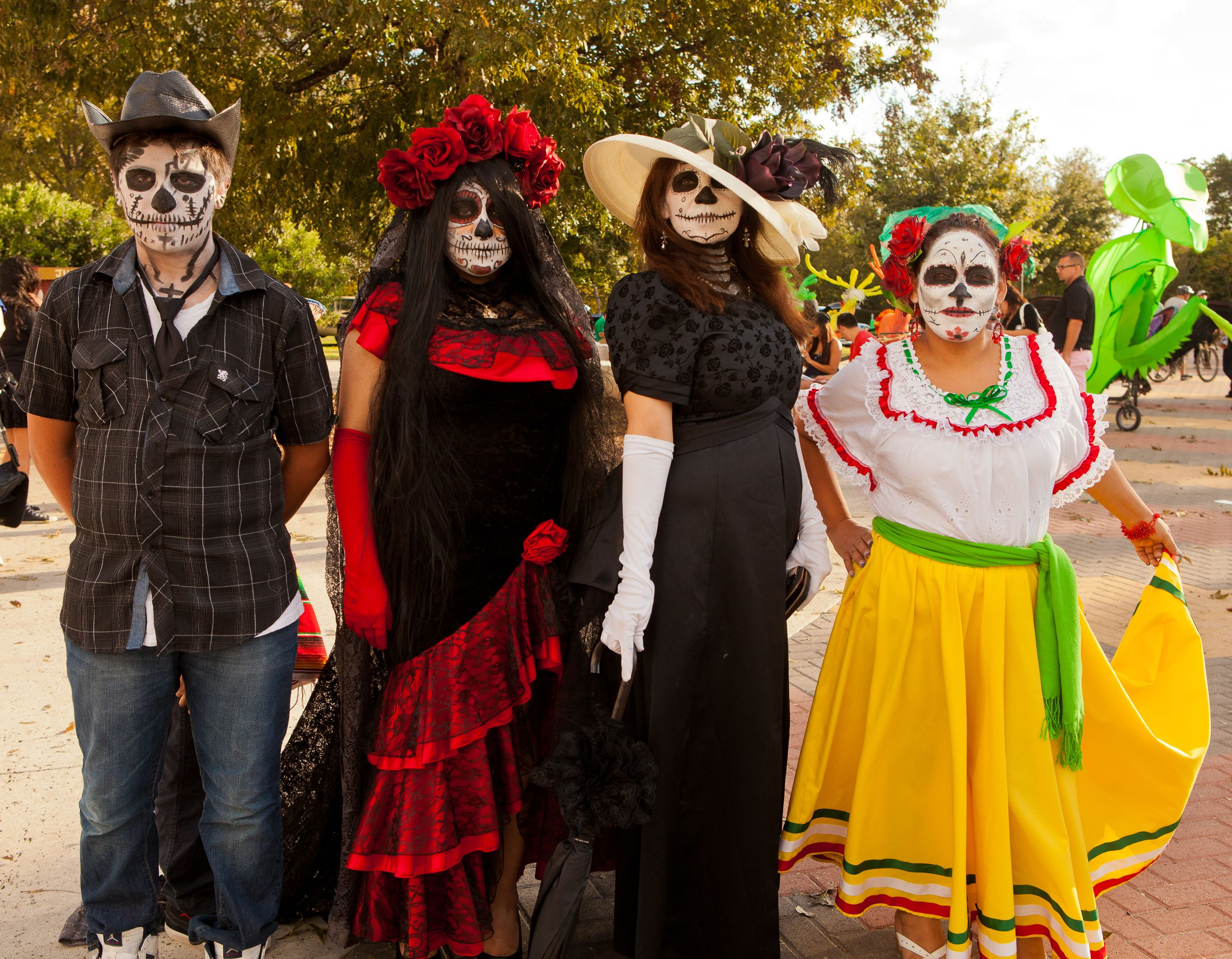 Siblings dressed for Día De Los Muertos