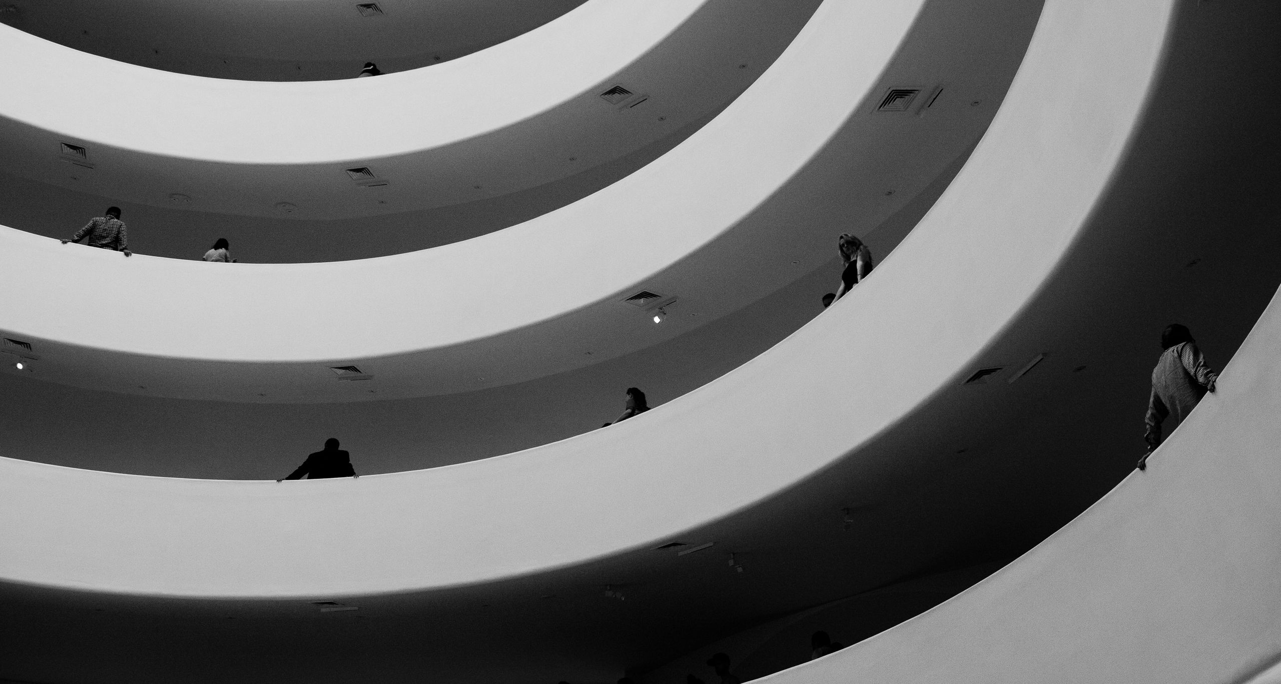 Visitors rest on the railings at the Guggenheim