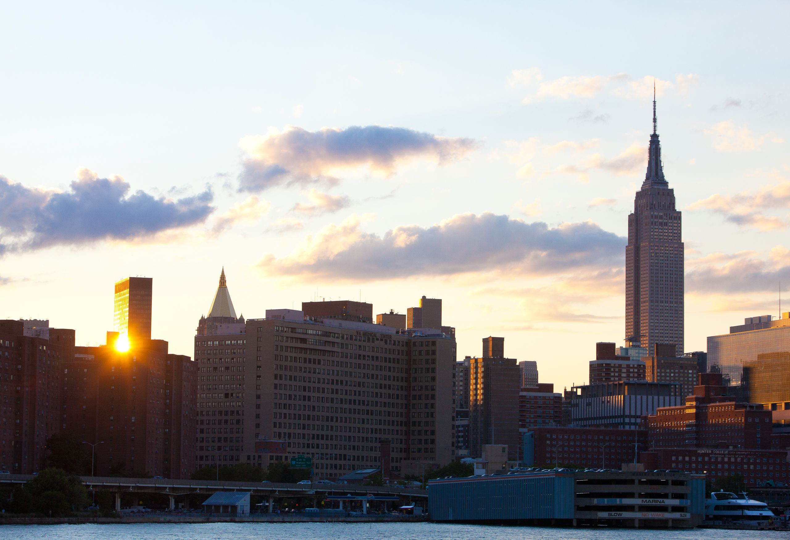 Empire State Building and setting sun as seen from the East River
