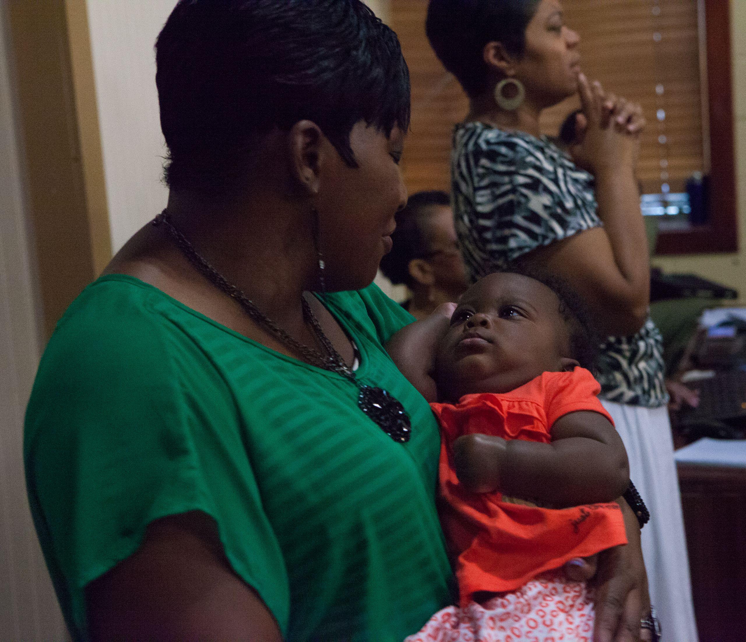 A parishioner named Andrea cradles her newborn son