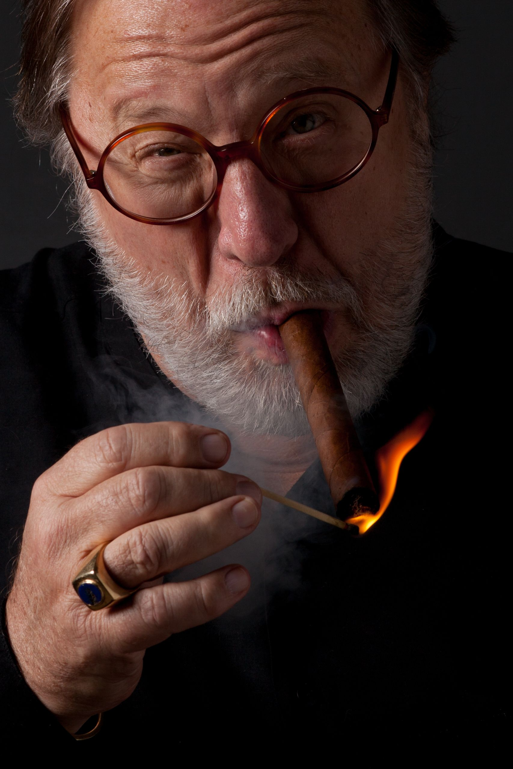 Chuck Robison lighting cigar