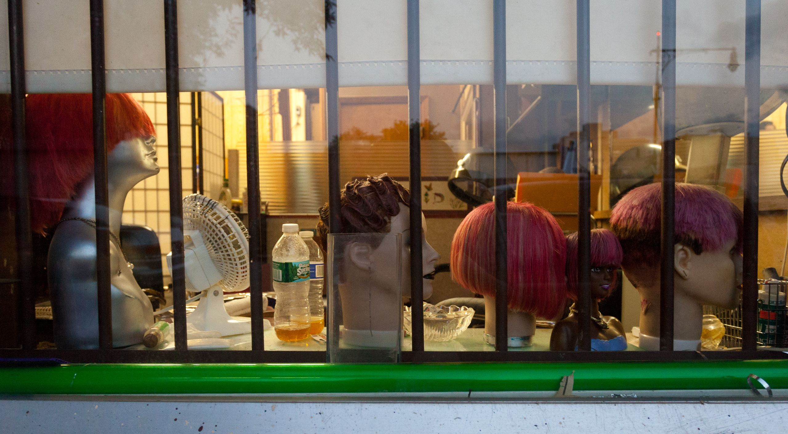 Wigs on display at a Clinton Hill barbershop