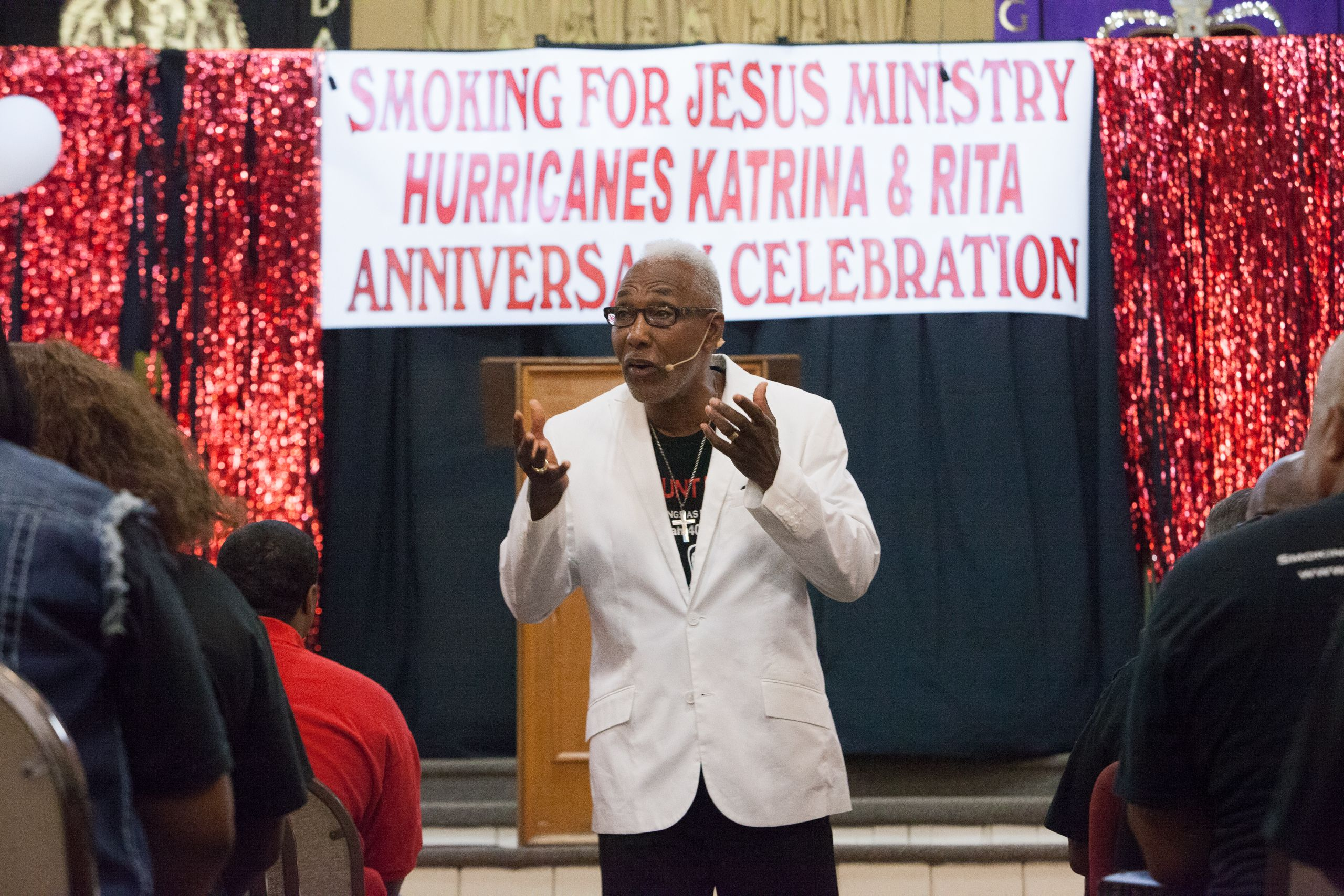 Pastor Monnet addresses his flock on the anniversary of their departure from New Orleans