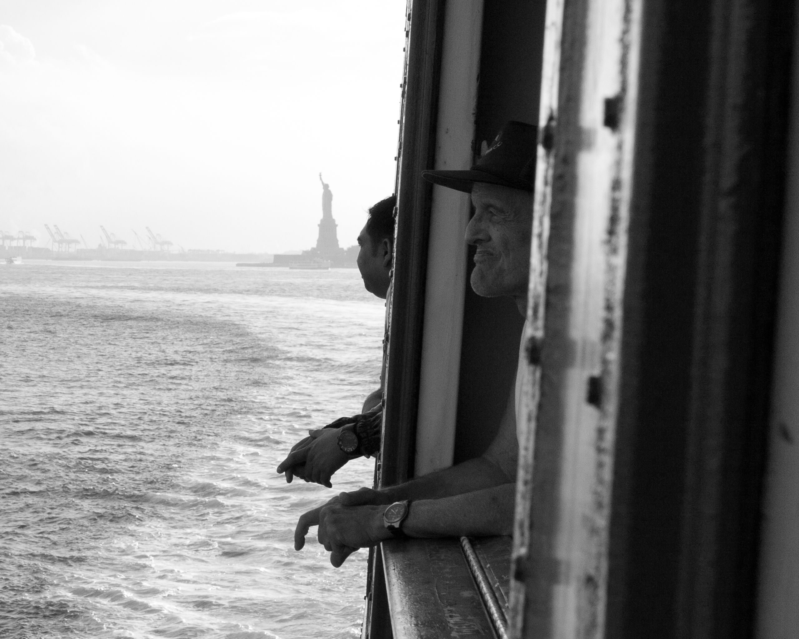Passengers aboard the Staten Island Ferry view the waterway