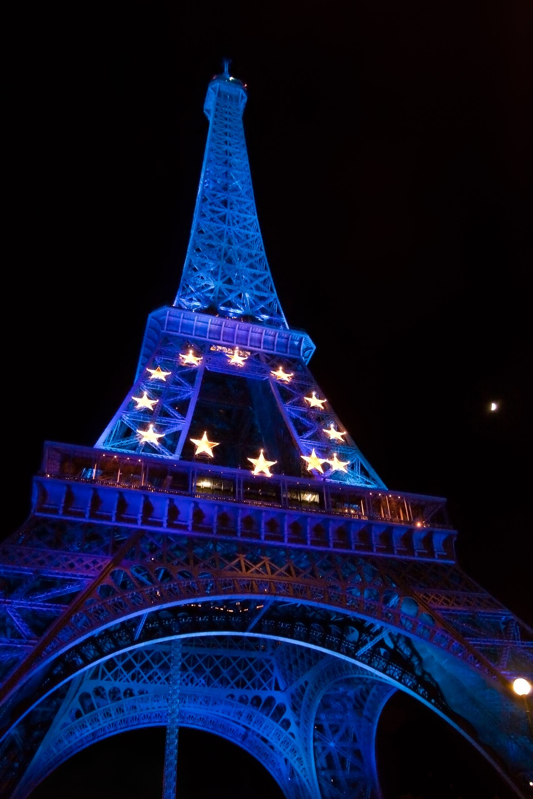 The Eiffel Tower At Night With Moon